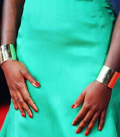 @Who What Wear - Lupita Nyong'o                 Event: British Academy Film Awards  Matching Ana Khouri yellow gold cuff bracelets made for a tough-yet-sophisticated addition to Nyong'o's green Dior gown.