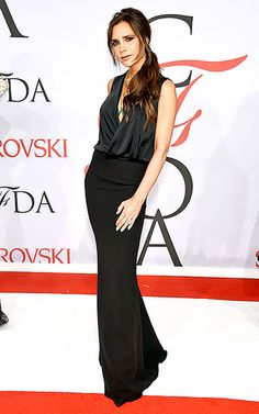 Victoria Beckham highlighted her slim figure in a plunging, sleeveless dress.