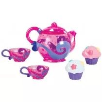 Pink teapot includes a strainer and a rattler that shakes when empty. Set also includes frosted cupcake squirters with starfish sprinkles. Tea cups include strainers that allow water to flow through for visual stimulation and multiple play patterns.