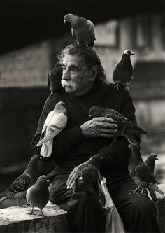 Man posing with pigeons in...: Photo by Photographer Bjørn Sagen - photo.net