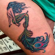Awesome mermaid with a funky looking tail! Tattoo by Cookie. #Cookie #cookietattooer #traditionaltattoo #mermaid #feather