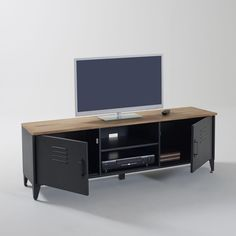 Fans of stylish interiors will love the timeless, modern industrial style of this HIBA TV unit crafted from matt black lacquered steel with a solid oak top. Modern Industrial, Industrial Furniture, Tv Storage Unit, Grande Niche, Tv Bank, Tv Unit Design, Tv Design, Wall Mounted Tv, Fashion Room