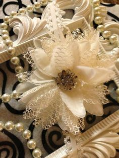 White lace flower headband embellished with by AngelKissBoutique, $10.99