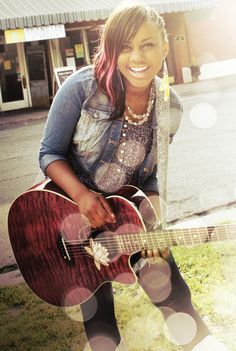 Jamie Grace. She is a great singer. I have the same brand of guitar as her!!!