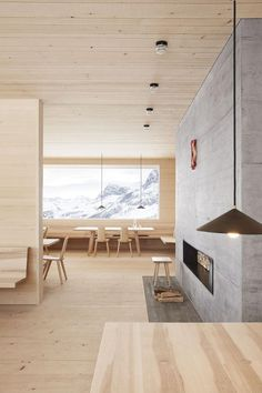 Nature dialogues constantly with architecture in two projects by architect Bernardo Bader a chapel and a mountain lodge in the Austrian Alps. in News Design. Scandinavian Fireplace, Scandinavian Home, Interior Design Colleges, Interior Minimalista, Wood Architecture, Outdoor Kitchen Design, Wood Interiors, House Interiors, Minimalist Interior