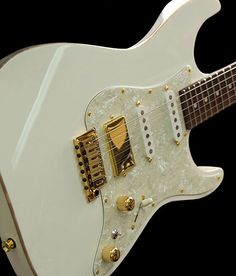 Tom Anderson Guitar... I would give anything to own a Tom Anderson!  My God, this is a sexy instrument...