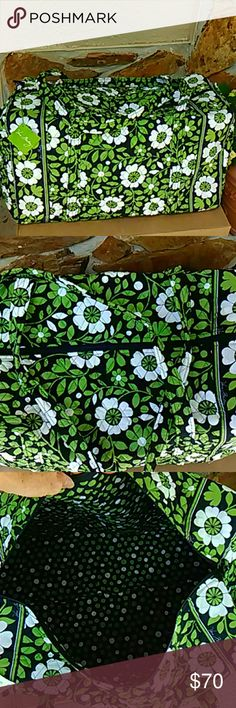 NWT Large Duffel by Vera Bradley Brand new duffel in navy, green and white floral print.  Lucky dots polka dots inside.  This bag will hold a LOT!  Perfect for overnights, travels, and anytime you need to carry a lot of things.  Bright, cheerful print.  Lucky You! Vera Bradley Bags Travel Bags