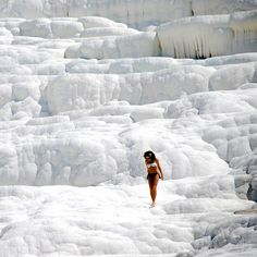 """No this is not """"SNOW"""" it is white petrified lime that cascades naturally.  Located in Pamukkale,Turkey,  the city contains hot springs and travertines, terraces of carbonate minerals left by the flowing"""