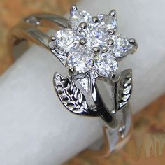 SZ 8 Gorgeous LC White Topaz Flower Ring  is going up for auction at  5pm Thu, May 16 with a starting bid of $7.