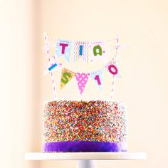 Rainbow sprinkle bunting birthday cake