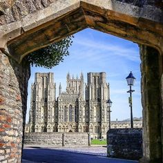 Wells in Somerset, England's smallest city, which feels almost frozen in time. Its cathedral (pictured) is the earliest to be built in the English Gothic style and the nearby 13th-century Bishop's Palace is surrounded by a spectacular moat that's home to swans who ring a bell to receive food - if only we could do that too! Thanks for sharing this wonderful shot with us @jcmphotographyuk #VisitEngland #ThrowbackThursday #Picturesque #Somerset