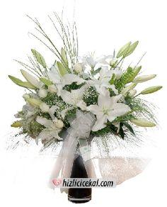 Vazoda 11 Gül ve Lilyumlar  Hızlı Çiçek Al ile sevdiklerinize aynı gün teslimat seçeneği ile cam vazo içinde 11 adet beyaz güller ve 3 dal beyaz lilyum çiçekleri sipariş edin.  http://www.hizlicicekal.com/cicekler/cicekciler/cicek/110/vazoda-11-gul-ve-lilyumlar/