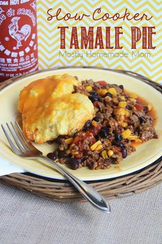 Slow Cooker Tamale Pie - Ground beef seasoned with cumin and chili powder, slow cooks with black beans, corn, tomatoes, and chilies and then topped with cornbread and cheese - the perfect one-pot meal!