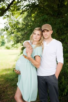 Love this pose for a maternity shot... except they need to smile... why does everyone look like their life is over in maternity shots?