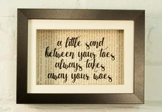 A Little Sand Between Your Toes Always Takes Away Your Woes Inspirational Quote Upcycled Vintage Book Page 6x8 Framed Art Shadow Box. We love to give new life to old books with messages of hope, love and strength. We up-cycle the beautiful, weathered pages to create unique prints that glow with the patina of another age, so no two are alike. The result is a beautiful and interesting home decor print. Definitely a conversation starter! Our prints are currently created using vintage books...