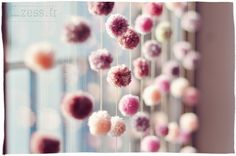 """I love the idea of doing a curtain of pompous like this but all in white or cream as """"snowflakes"""" for wintertime window decoration"""