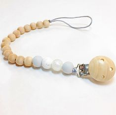 Soother clip and teether in one! Perfect for cliping on toys too! Baby Accessories, Beaded Bracelets, Jewels, Toys, Handmade, Fashion, Activity Toys, Moda, Hand Made