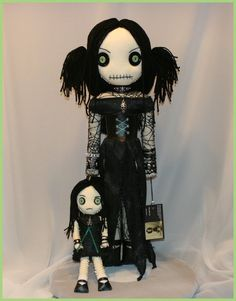 https://www.etsy.com/listing/221711996/ooak-hand-stitched-rag-doll-creepy?ref=shop_home_feat_1