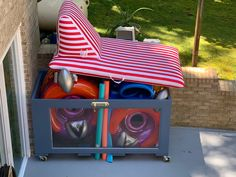 Used old doors left over around the house and some left over wood.  Altogether makes pool toy organizer.