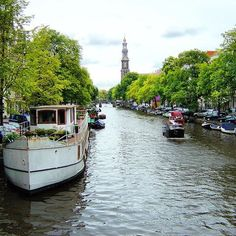 I prefer river to lake. It flows. #amsterdam #travel #canal #frombridge #river #water #boat #netherlands