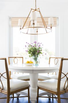 White Round Dining Table with Bamboo Dining Chairs - Transitional - Dining Room Interior Exterior, Home Interior, Interior Design, White Round Dining Table, Round Tables, Bamboo Dining Chairs, Gold Chairs, Rattan Chairs, Cosy Home