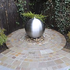 Small Solar Powered Water Feature. Brushed Stainless Steel Sphere with LED light. Outdoor garden fountain.