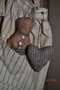doll in apron pocket with heart