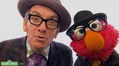 Elmo hanging out with Elvis Costello.