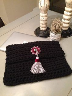 Handmade crochet clutch with ethnic touch by Remysoneandonly