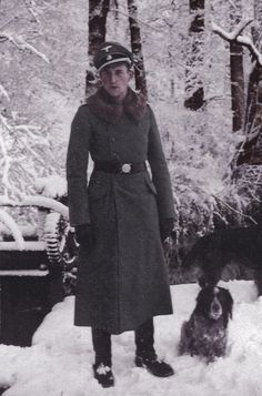 A Waffen-ϟϟ officer with his dog during winter maybe eastern front.