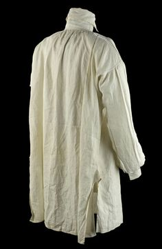 This shirt is an example of the type of non-regulation garment that was worn with uniform. The shirt features a high collar, which fastens with two Dorset buttons. A stock would have been worn around the neck so that only the edges of the collar were visible. The construction of the shirt is quite full, particularly the sleeves which are pleated. This would enable the wearer to fit into the relatively tight armed coats of the period. (1807)
