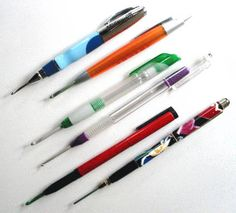FreeCraft has a basic tutorial for taking apart old pens and replacing the innards with a crochet hook.