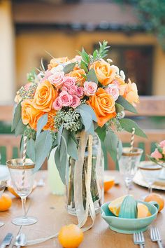Orange and peach rose centerpiece | Amy Carlston Photography | see more on: http://burnettsboards.com/2014/07/summery-citrus-wedding-ideas/