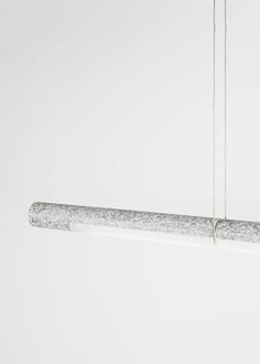 From Industrial Design is a collaboration between Manuel Amaral Netto, Cesare Bizzotto and Tobias Nitsche. Volta lamp is a ceiling lamp that plays with the typology of the traditional fluorescent tube lighting. Volta is a simple extruded aluminium profile, but its use of LED strips mean that it may be used as a directional light. Volta is suspended from loops of copper wiring that conduct electricity to the light, but the body of the lamp may be rotated independently from these cables. ...