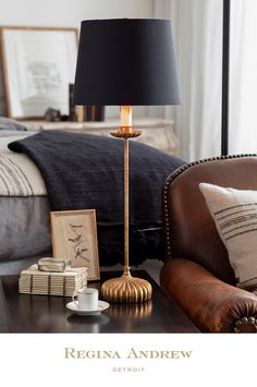 Add a touch of elegant style to your home with the Clove Stem Buffet Lamp. With a dramatic base finished in antiqued gold, this table lamp brings a touch of sophistication to any decor. A black linen shade completes the refined look. Home Lighting, Lighting Design, Farmhouse Floor Lamps, Buffet Table Lamps, Comfort And Joy, Interior Design Tips, Beautiful Bedrooms, Home Decor Inspiration, Black Linen