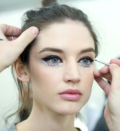 Black cat eye #makeup with iridescent glittery lower eye line & rose nude lips | Chanel Spring Summer 2014 Couture.