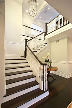GORGEOUS stair case!!!! ~ dark wood floors, treads, white panelled walls, white spindles, dark handrail