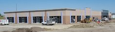 Precast; Concrete; Retail: Ace Hardware Store - Bismarck, ND; General Contractor/Architect: Northwest Contracting Inc.; Engineer: CWStructural Engineers; Products: Insulated Wall Panels; Finishes: Sandblast; Thin Brick