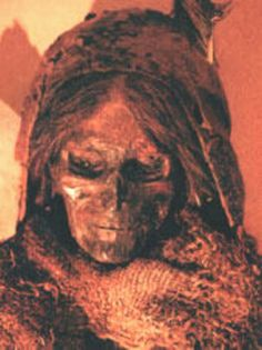 "One of the most famous Tocharian mummies found, the so-called ""Beauty of Loulan""; and right, her face as reconstructed by an artist. ""Beauty of Loulan"" The oldest mummies found in the Tarim Basin come from Loulan located at the east end of the egg shaped Taklamakan Desert. Dressed only in shades of brown, she was alive as early as 2000 B.C. during the era of Abraham and the patriarchs. She died when she was about 40. Next to her head there is a basket which contains grains of wheat."