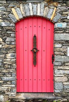 Unique pink door with surrounding stonework in Brissago, Ticino, Switzerland. Door Knockers, Door Knobs, Door Handles, Cool Doors, Unique Doors, Entrance Doors, Doorway, When One Door Closes, Door Gate