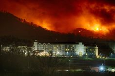 Three people were killed, and the Tennessee towns of Gatlinburg and Pigeon Forge were preparing for another round of fire-whipping winds.