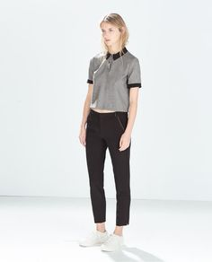 Image 1 of TROUSERS WITH FAUX LEATHER PIPING from Zara