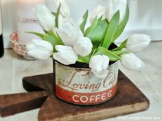 white tulips in a can