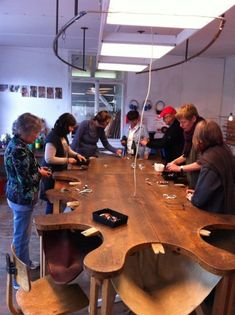 JSI Jewelry Workshop in Switzerland - really cool table. You can see the jewelers  bench pins in the hollows of the tables . What a marvelous workshop!