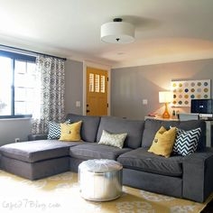Like this sectional sofa. Also like the touches of color--not necessarily the colors themselves, just how they're brought in to the room with the door, lamp, curtain rod, rug, artwork...