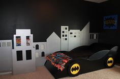 Batman room! MDF cityscape and building bookshelf. Not to mention Batmobile Bed.