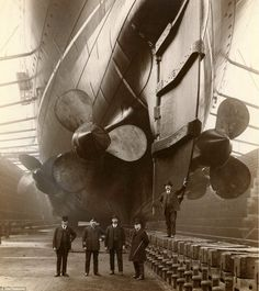 Canada Dock in Liverpool, 1909. The gentleman in uniform is RMS Mauretania's first Chief Engineer, John Currie    Read more: http://www.dailymail.co.uk/news/article-2263881/From-pipe-smoking-dogs-Churchills-meeting-end-Second-World-War-Five-years-Flickrs-hidden-treasures-thousands-amazing-images.