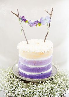 ombre purple layer cake with floral bunting