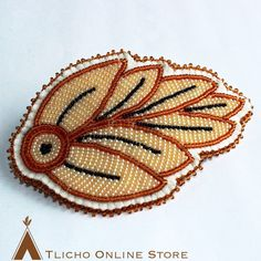 Beaded feather for you spring hairdo! Made by Lucy Ann Takazo from #Gamètì.