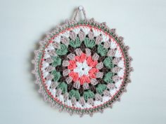 Potholder; variation of Granny Mandala pattern by Alice Best; original pattern available for free at Ravelry
